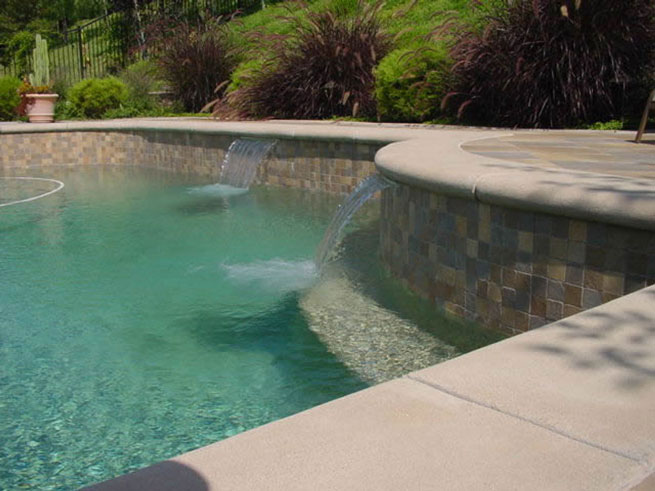 How to build your own pools rockslides waterfalls how for Build your pool